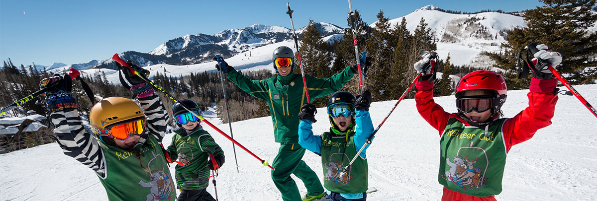 A youth ski instructor with his lesson group