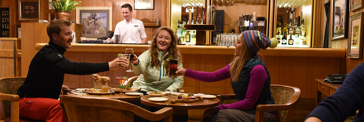 three guests cheersing inside
