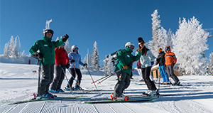 A group of skiers with Mountain Hosts