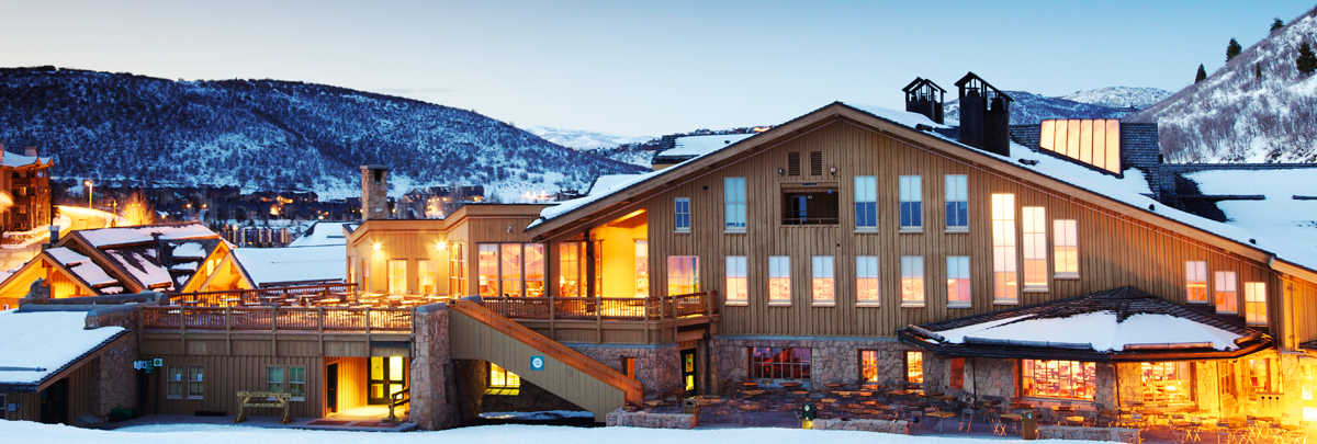 Exterior view of the back of Snow Park Lodge at dusk