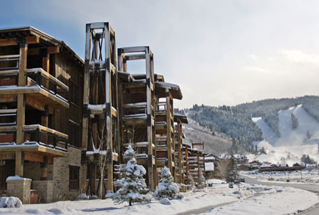 Exterior image of Silver Baron Lodge with Deer Valley slopes in the background