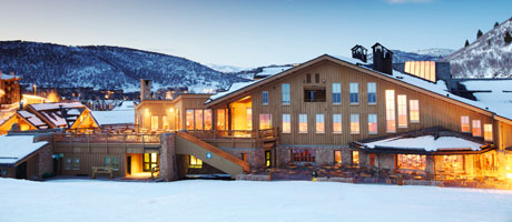 Exterior winter image of Snow Park Lodge at dusk