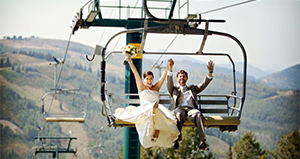 A bride and groom riding the lift during summer
