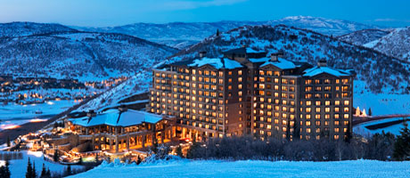 Exterior view of St. Regis Deer Valley at dusk with views of snow covered mountains
