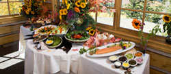 Event set-up on the deck of Silver Lake Lodge with bouquets of flowers on tables