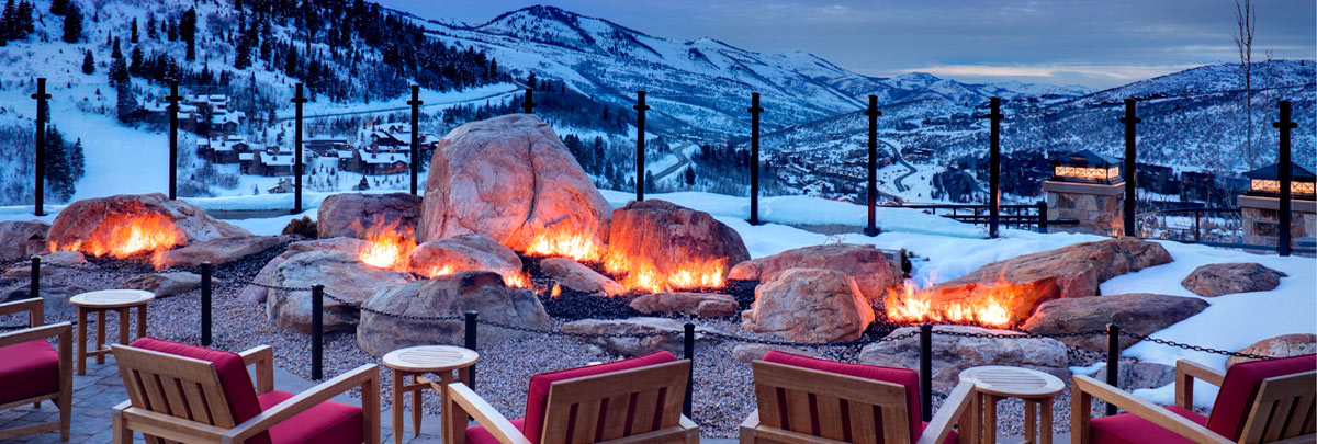 The outdoor fireplace at St. Reigs with a viw of Deer Valley and the Wasatch Mountains