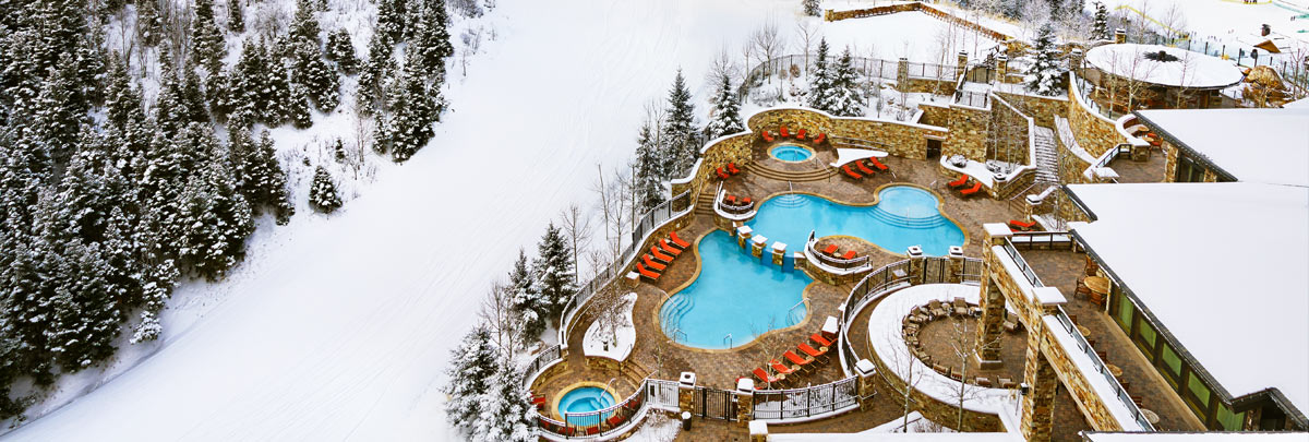 Aerial winter view of the St. Regis pool and hot tub area along Deer Valley's ski slope