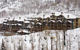 Exterior winter view of Black Diamond Lodge and ski slope