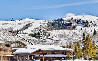Exterior winter view of Deer Valley Plaza with snowy mountains in the background