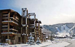 Exterior winter view of Silver Baron Lodge with Deer Valley ski slopes in background