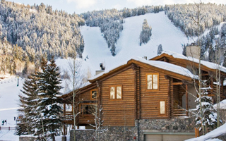 Exterior winter view of Trail's End Lodge with Deer Valley slopes in background