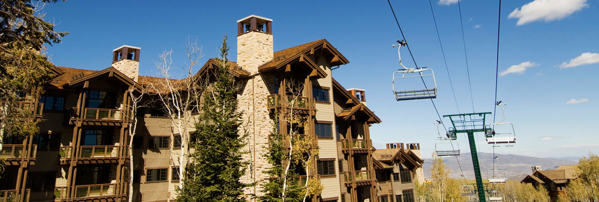Exterior summer view of Arrowleaf condominiums and ski lift