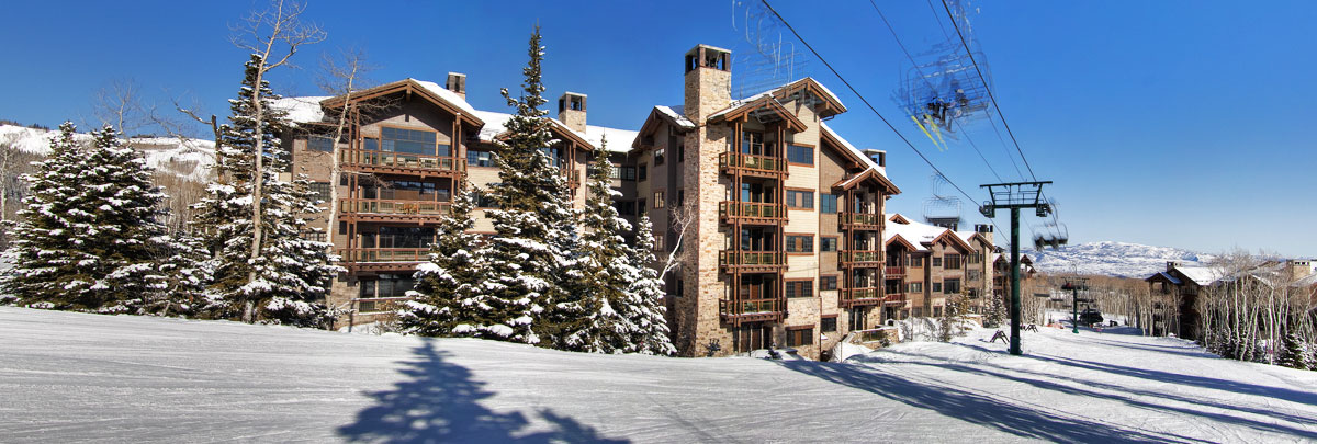 Exterior winter view of Arrowleaf condominiums and ski lift