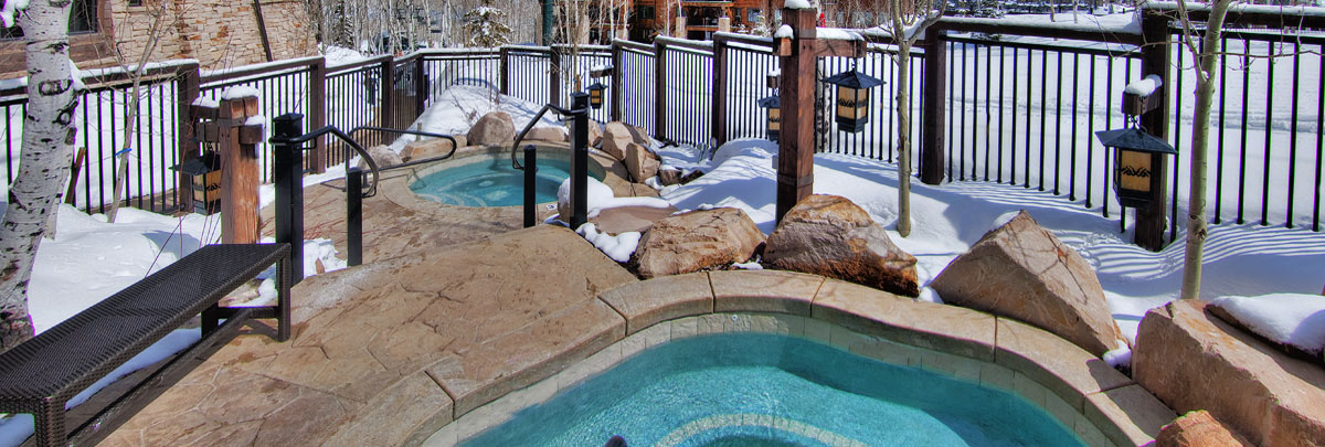 Exterior winter view of two Arrowleaf hot tubs
