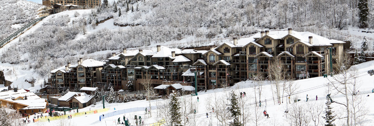 Exterior winter view of Black Diamond Lodge and ski slopes