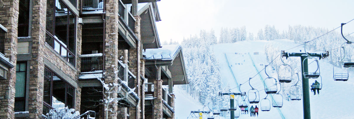 Exterior winter view of Black Diamond Lodge and Burns chairlift