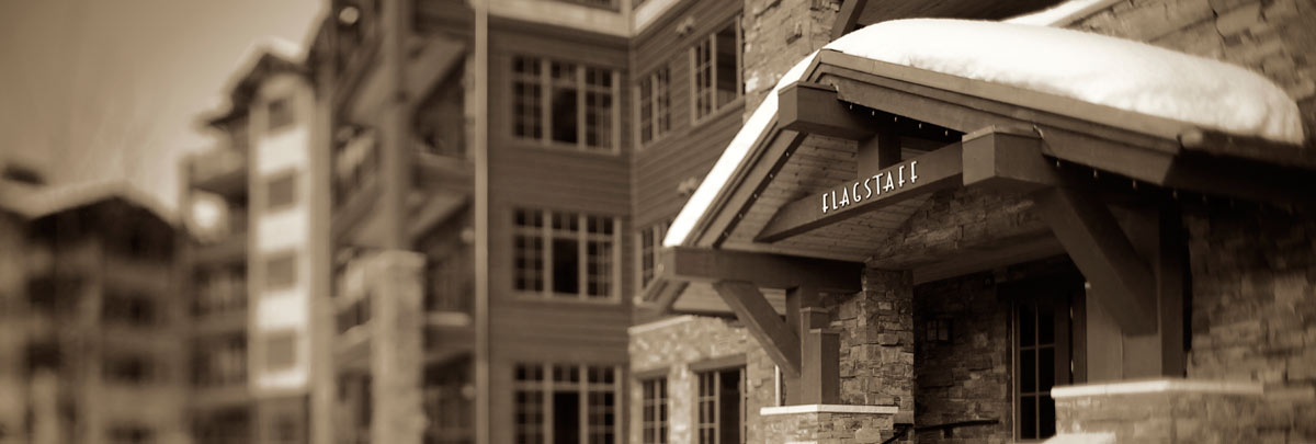 Sepia image of an exterior winter view of Flagstaff Lodge