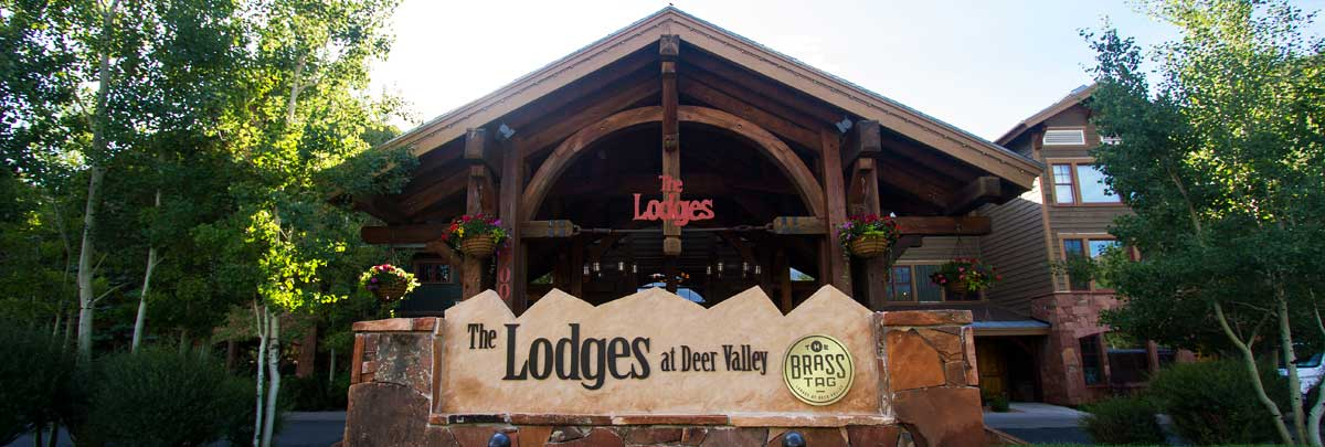 Exterior summer view of the sign in the front of Lodges at Deer Valley