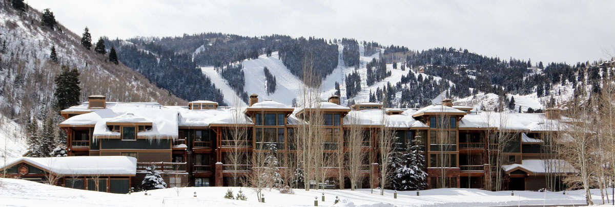 Exterior winter view of Lodges at Deer Valley with Deer Valley ski slopes in the background