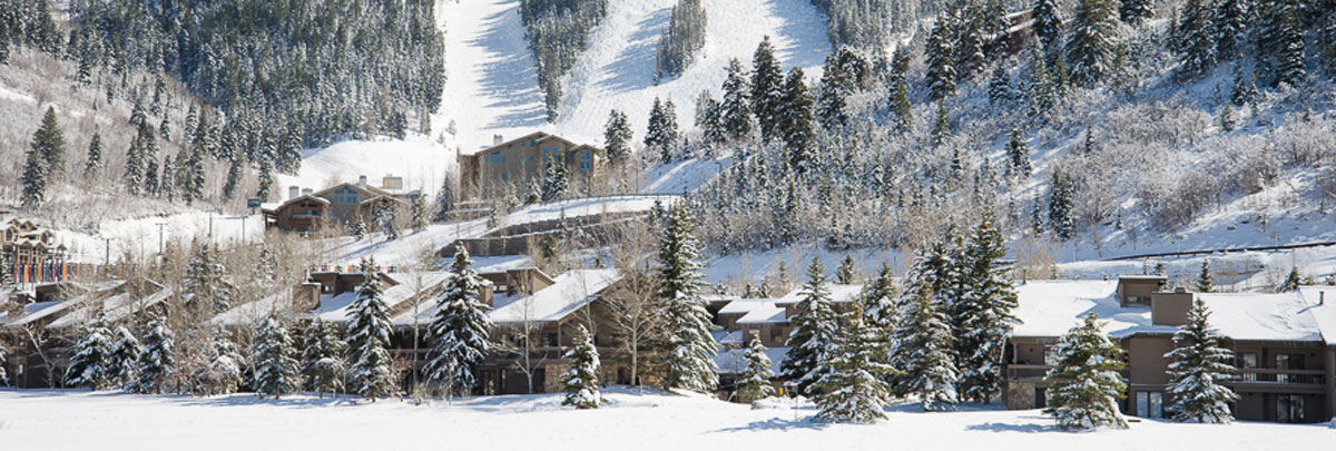 Exterior winter view of Lakeside with Deer Valley ski slopes in the background