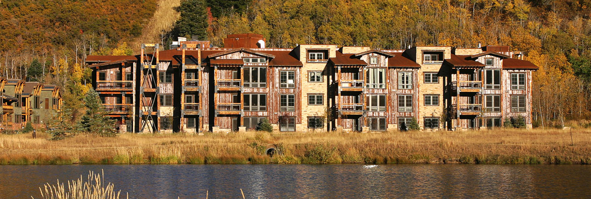 Exterior fall view of Silver Baron Lodge in front of a Deer Valley area pond