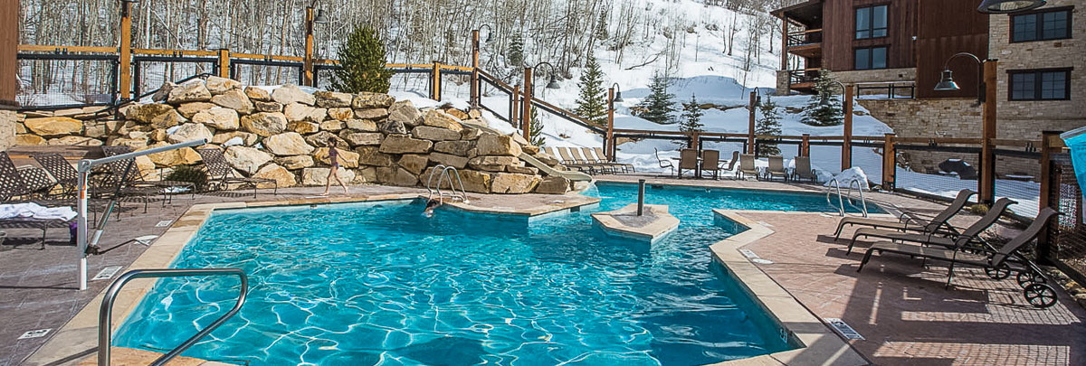 Exterior winter view of outdoor swimming pool at Silver Baron Lodge