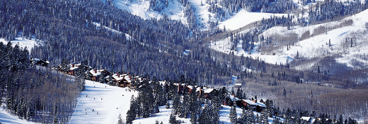 Exterior winter aerial view of Stag Lodge and views of Deer Valley ski slopes