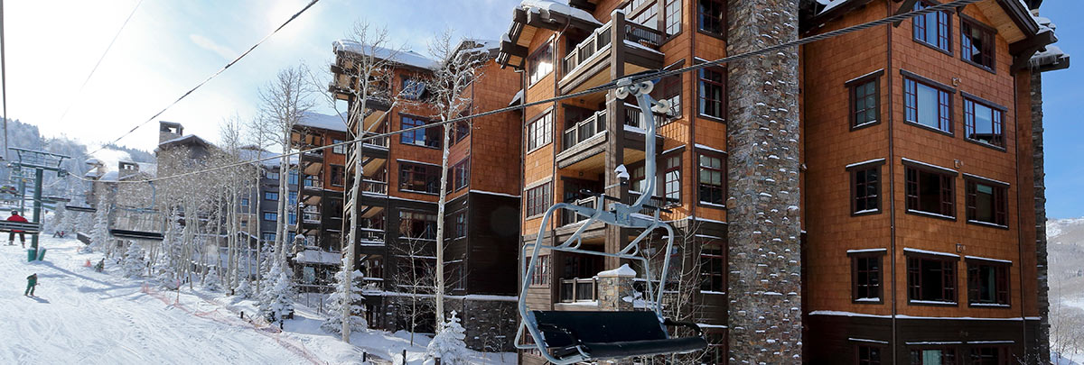 Exterior winter view of Flagstaff Lodge with chairlift and skiers