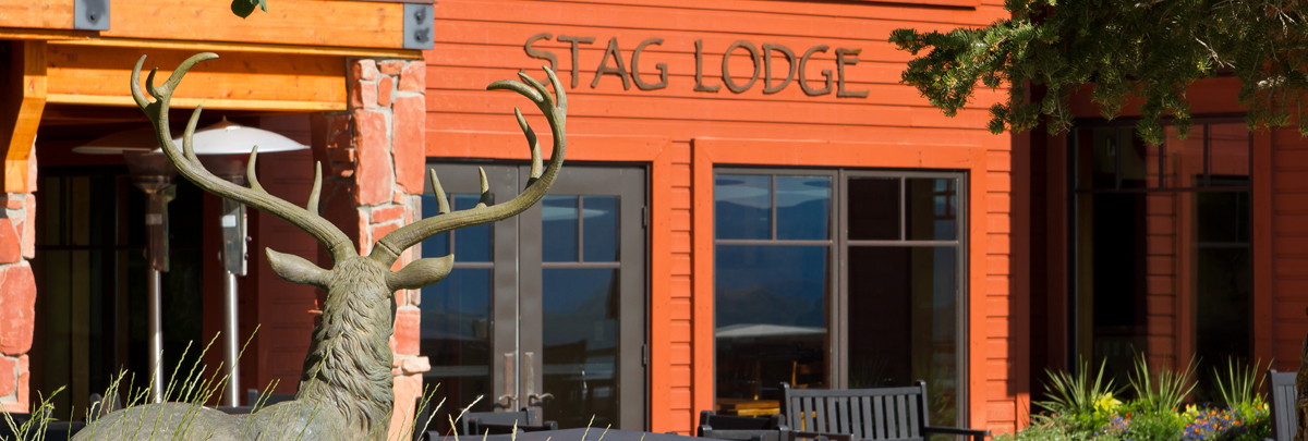 Exterior winter view of the outside patio and dining area of Stag Lodge