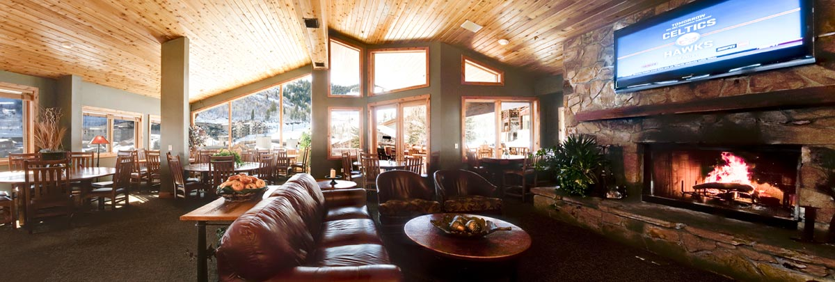 Interior view of après-ski area of Trail's End Lodge and guests