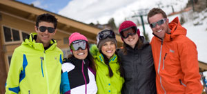 Group of five skiers posing to have their photo taken
