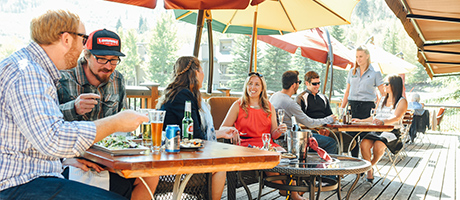 Guests eatting outside on the Deer Valley Grocery Café deck