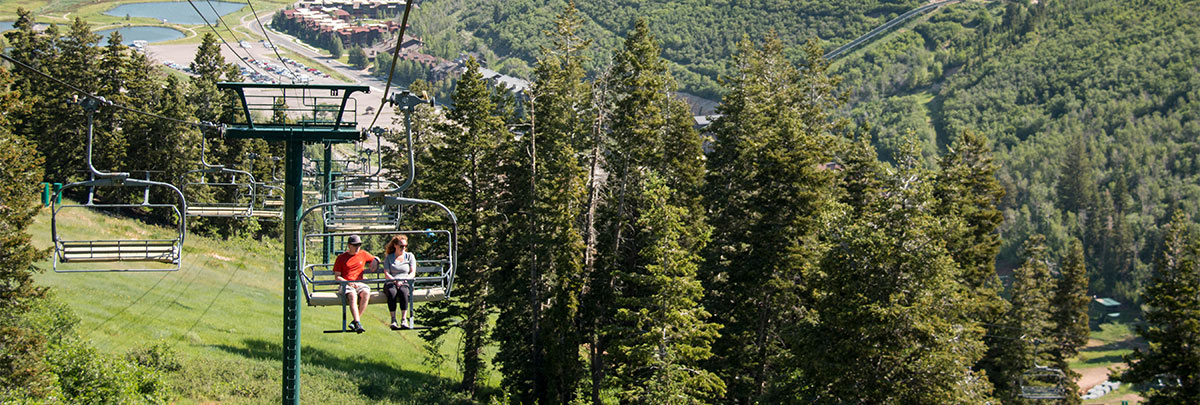 a couple taking a scenic chairlift ride on silver lake express
