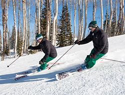 Mahre Brothers skiing down a groomed slope