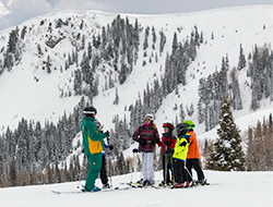 Scenic Image with group of teen skiers with a Ski Instructor
