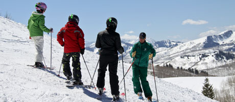 A group of teenagers with a ski instructor
