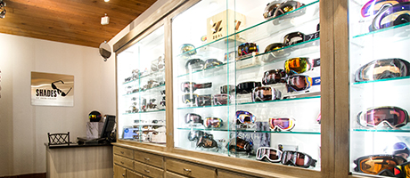 Image of the inside of the Shades of Deer Valley store with display cases full of ski goggles and sunglasses
