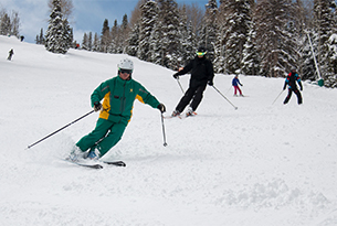 Teen Escape instructor skiing with class